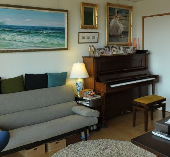A typical living room in Monsey, with artwork & family photos on the walls and a well tuned upright piano in the corner, well-tuned and ready for a Monsey family to play.